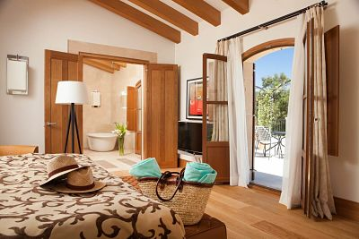 Inside view and to the garden of the Private Pool Suite at the luxury hotel in Mallorca Castell son Claret.