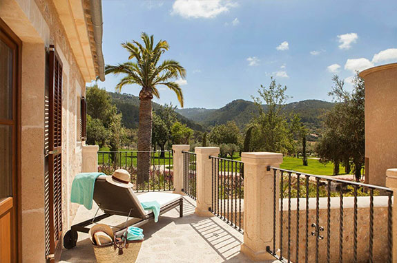 Exterior view of the Terrace Deluxe Double Room at the luxury hotel in Mallorca, Castell son Claret. View from the terrace to the Tramuntana Mountains.